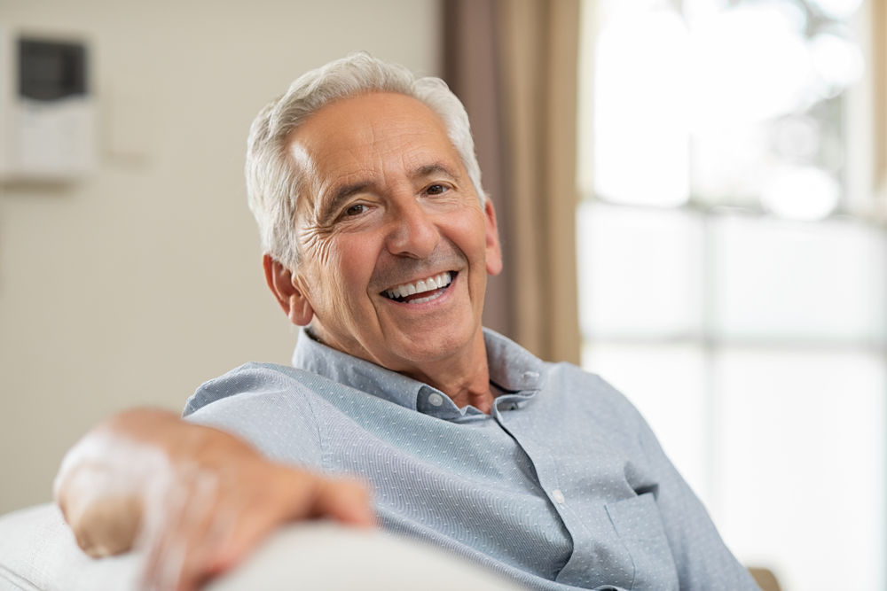 older man smiling | cosmetic dentist weston ma
