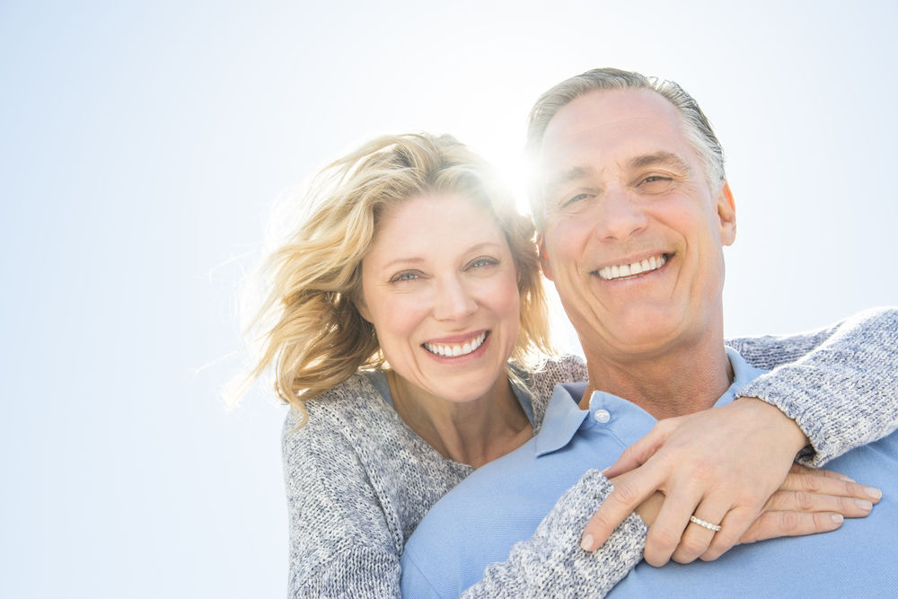 couple smiling dental implants weston ma
