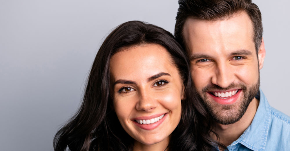 couple smiling dental crowns weston ma