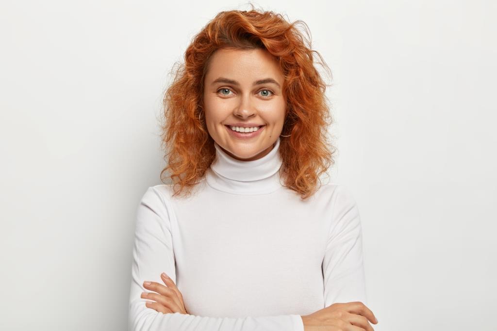 dental office Wayland | Pretty girl smiling.