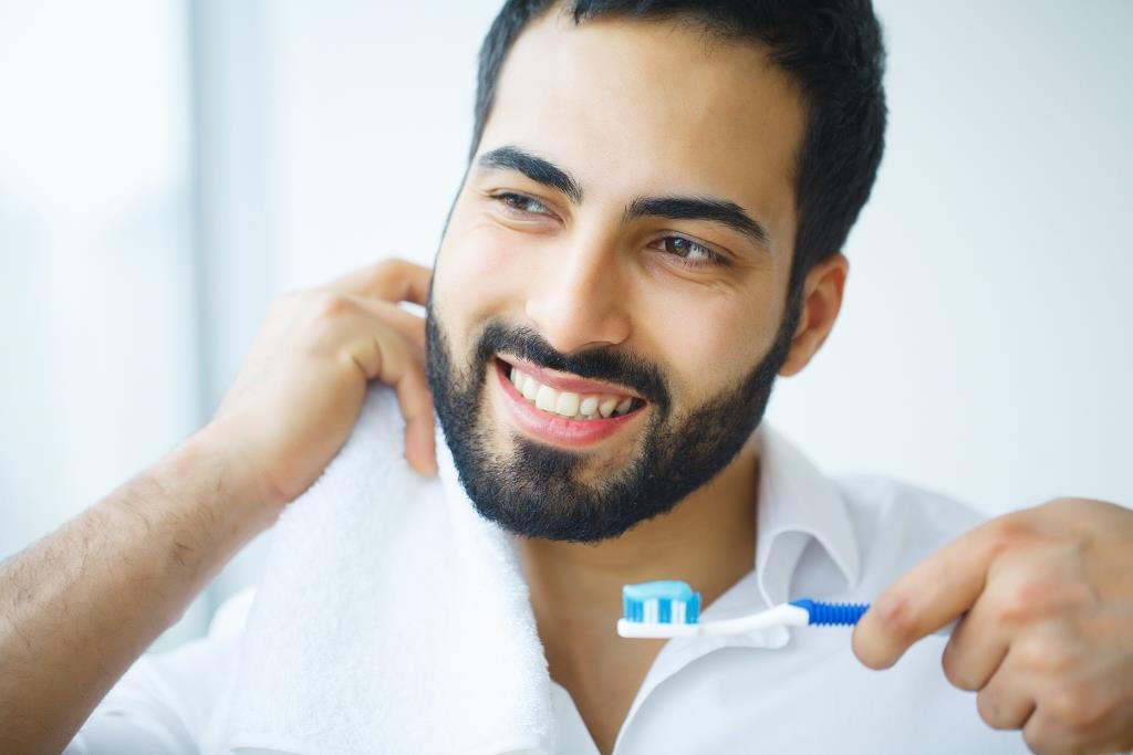 dentist in Wellesley MA | Male brushing his teeth.