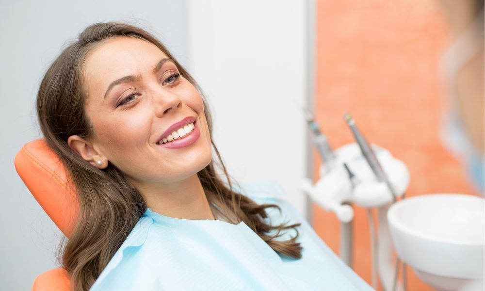 dental office Weston MA | Happy dental patient.
