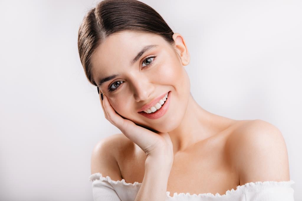 Cosmetic Dental Treatment | Happy beautiful gir.